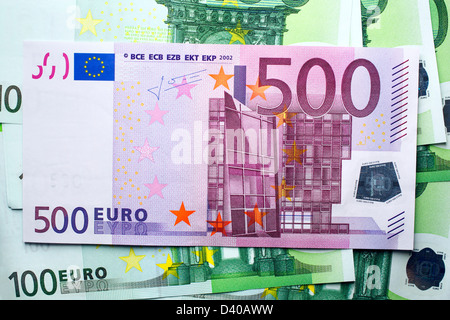 500 Euro banknote, Modern architecture and bridge and 100 Euro banknktes as background - Stock Photo