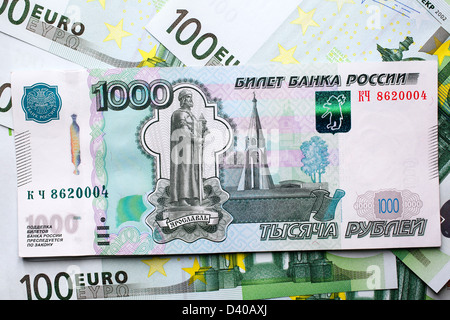 1000 Rubles banknote, Russia (1997) and 100 Euro banknotes as background - Stock Photo