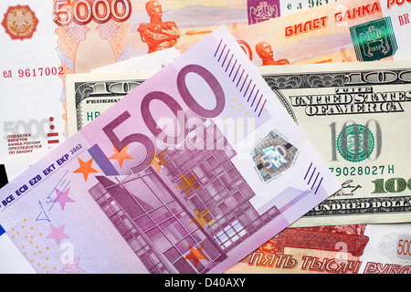 500 Euro banknote, 100 Dollars banknote and 5000 Russian Rubles banknotes in background - Stock Photo