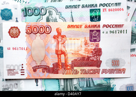 5000 Rubles banknote and 1000 Rubles Russian banknotes in background - Stock Photo