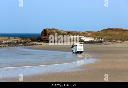 Tourist sightseeing bus at the Bluff on Ninety Mile Beach in Northland - Stock Photo