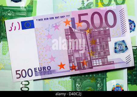 500 Euro banknote and 100 Euro banknotes as background - Stock Photo