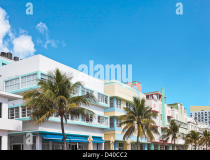 a row of buildings in art-deco style lining ocean drive's art deco district, in south beach, miami - Stock Photo