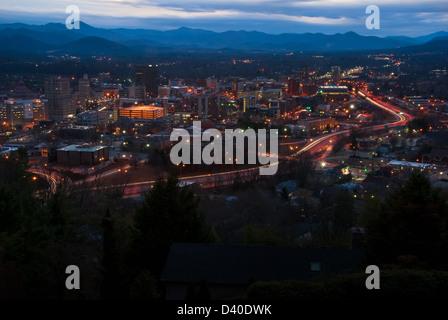 Asheville, North Carolina cityscape and mountain skyline at late dusk. - Stock Photo