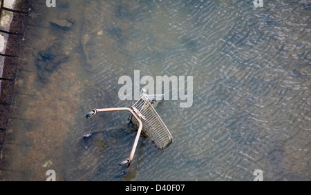 Shopping trolley thrown into River Gipping, Ipswich, Suffolk, England - Stock Photo