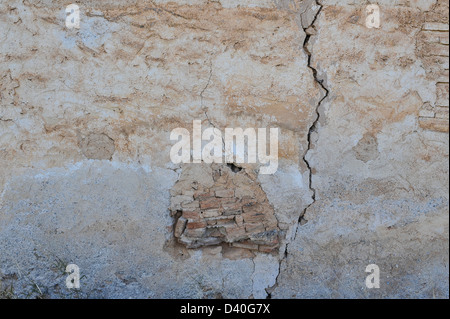 An old cracked wall seen in detail. - Stock Photo