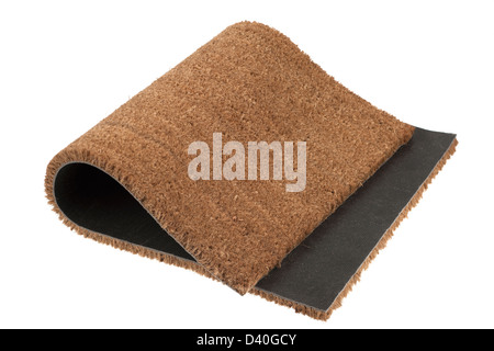 Folded rubber backed coir floor mat - Stock Photo