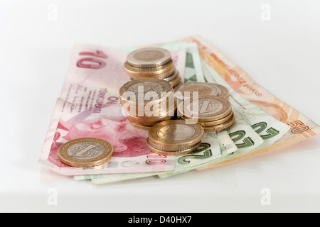 Turkish Lira coins on banknotes with reflective surface - Stock Photo
