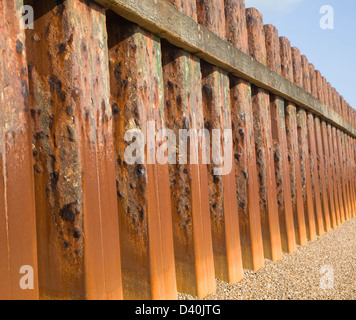 Rusty steel piling sea wall defences and shingle beach near Bawdsey Quay, Suffolk, England - Stock Photo