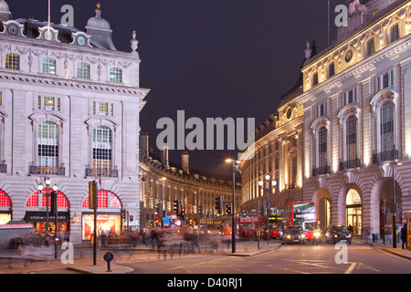 London Regent Street from Piccadilly Circus at dusk with taxis and buses - Stock Photo