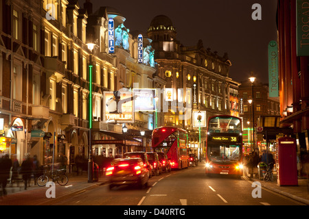 Heart of London theatreland, Shaftesbury Avenue: Lyric, Apollo, Gielgud, Queens theatres with 2 buses, inc new Routemaster - Stock Photo