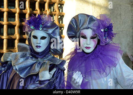 Some masks with beautiful costumes during 2013 carnival; Venice; Veneto, Italy. - Stock Photo
