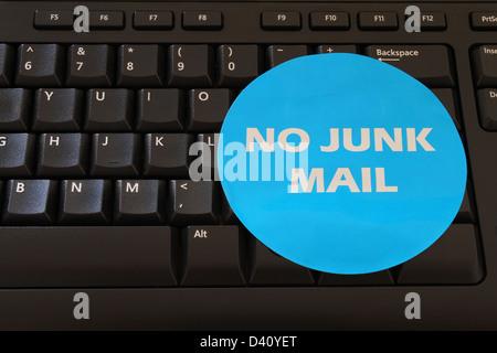No junk mail, sticker on black computer keyboard - Stock Photo