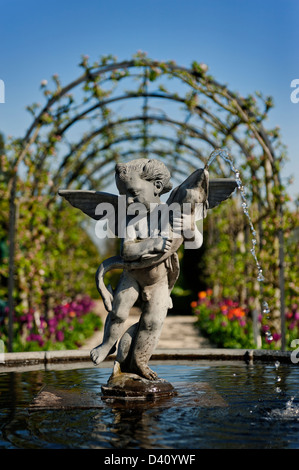 Fountain Statue of Eros in the Collector Earl's Garden at Arundel Castle, West Sussex, England, UK - Stock Photo