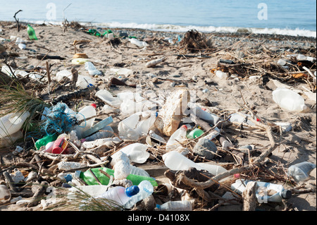 Plastic bottles and other rubbish and waste washed up on a dirty British beach - Stock Photo