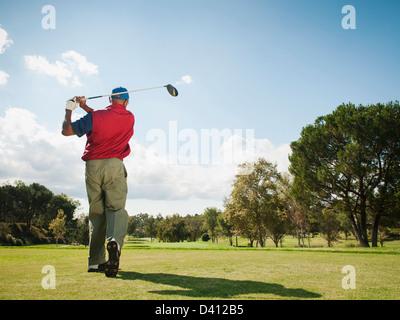 Black man playing golf - Stock Photo