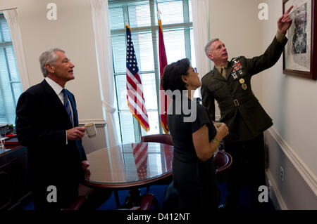US Secretary of Defense Chuck Hagel and his wife Lilibet are given a tour by his senior military advisor, Marine - Stock Photo