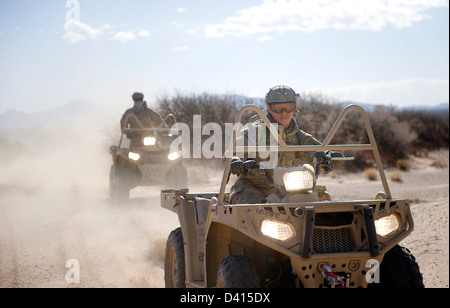 US Green Beret Special Forces soldiers perform off-road maneuvers with light tactical all terrain vehicles February - Stock Photo