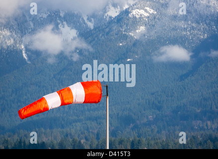 Wind cone against a mountain background. - Stock Photo