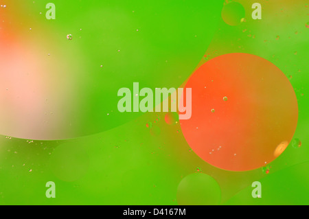 Abstract green background from floating oil bubbles in the water. - Stock Photo