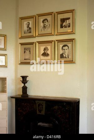 Framed photos of Hemingway at his house in Key West, Florida. - Stock Photo