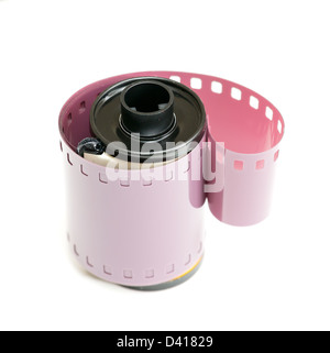 Macro image of 35mm film canister with coiled negative isolated on white background - Stock Photo