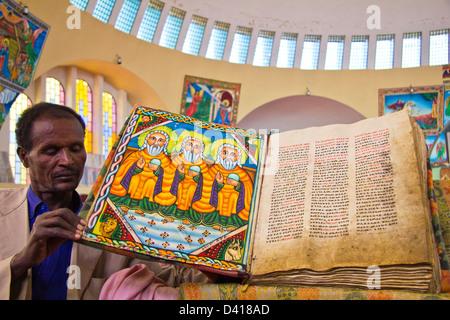 Ancient illuminated manuscript in St Mary of Zion Church Axum Ethiopia Africa - Stock Photo
