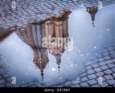 Sant'Agnese in Agone church in Piazza Navona reflected in pool of water, Rome - Stock Photo