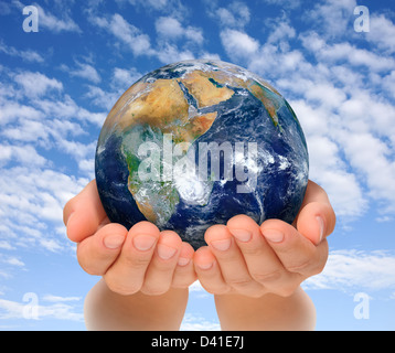 Hands of woman holding globe, Africa and Near East. - Stock Photo