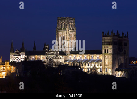 A view of Durham Cathedral floodlit at night as seen from an elevated position at Durham Railway Station - Stock Photo