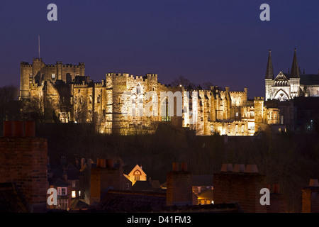 A view of Durham Castle floodlit at night as seen from Durham Railway Station in Durham City - Stock Photo