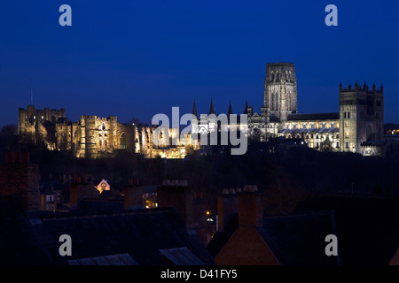 A view of Durham Castle and Cathedral in Durham City floodlit at night as seen from Durham Railway Station - Stock Photo