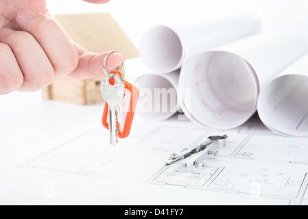 Blueprints hand with keys - Stock Photo