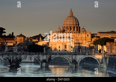 italy, rome, tiber river, ponte sant'angelo and st peter's basilica at dawn - Stock Photo