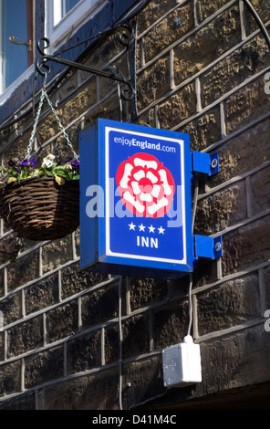 Close up of enjoyEngland.com rosette sign outside a small hotel and pub in Yorkshire, UK - Stock Photo