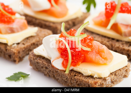 caviar salmon sandwiches on white - Stock Photo