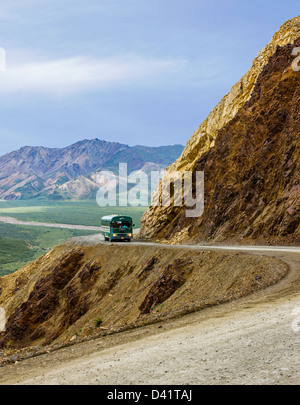 Buses shuttle visitors across Polychrome Pass on the limited access Denali Park Road, Denali National Park, Alaska, - Stock Photo