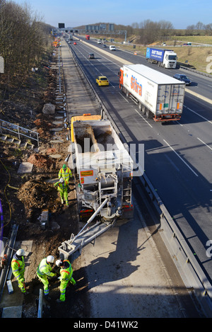 lorry delivering cement to construction workers working on M62 upgrade Leeds, Yorkshire, United Kingdom - Stock Photo