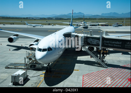 South African Airways Airbus A340 on a stand at Cape Town International Airport South Africa SAA passenger long - Stock Photo