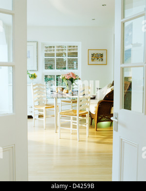Half Glazed Double Doors Open To Modern Conservatory Dining Room