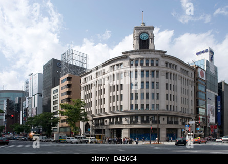 The 1932 Wako Building with landmark clock tower at intersection of Harumi-dori and Chuo-dori Streets in Ginza, - Stock Photo