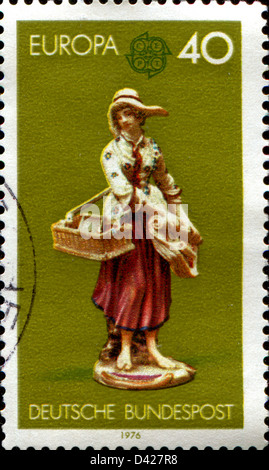 GERMANY - CIRCA 1976: a stamp printed in German Ferderal Republic shows Girl Selling Trinkets and Prints, Porcelain, - Stock Photo