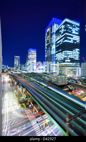 Elevated train lines and traffic in Ginza, Tokyo, Japan. - Stock Photo