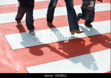 Luino, Italy, people walking over the zebra crossing in Luino - Stock Photo