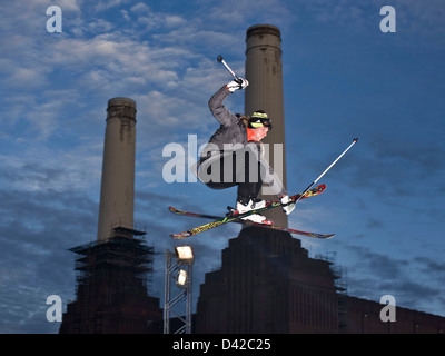 Urban skier in mid air action jump, Battersea power station - Stock Photo