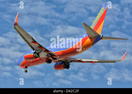 A Boeing 737 of Southwest airllines on final approach - Stock Photo