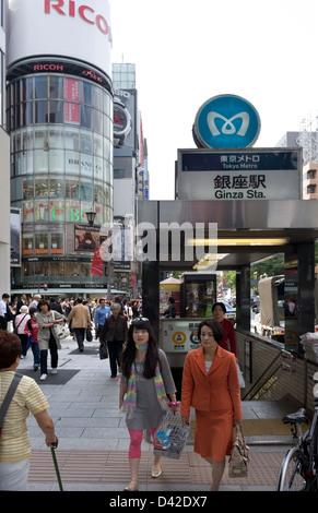 Metro subway entrance and historic Wako Building clock tower at intersection of Harumi-dori & Chuo-dori streets - Stock Photo