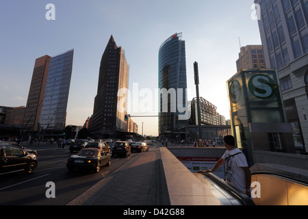 Berlin, Germany, subway entrance and the front buildings at Potsdamer Platz in the evening sun - Stock Photo