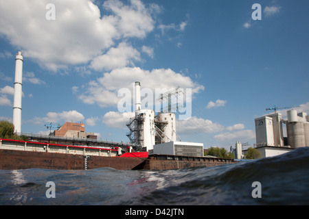 Berlin, Germany, the waves of the river Spree, Klingenberg power plant and cement plant in Berlin - Stock Photo