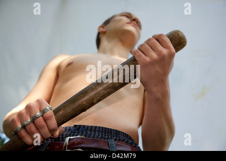 Freiburg, Germany, a young man with baseball bat - Stock Photo